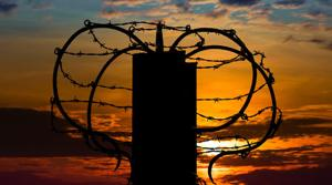Walls cannot be topped by razor wire or similar material