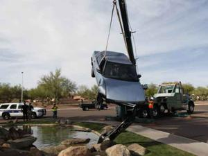 Car lands on Lakewood fountain