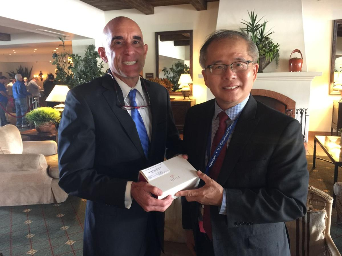 Ming-Shy Chen, right, deputy director general of the Taipei Economic and Cultural Office, presents Ahwatukee attorney Brian Foster with a gift for his work on behalf of Taiwanese businesses