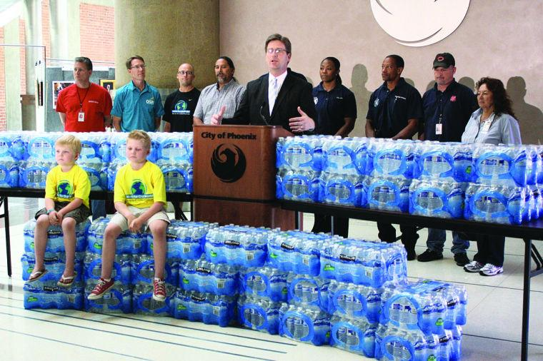 Greg Stanton makes a call for water