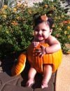 My Granddaughter London Olivia Vanderpool in a real pumpkin that her daddy carved for her.