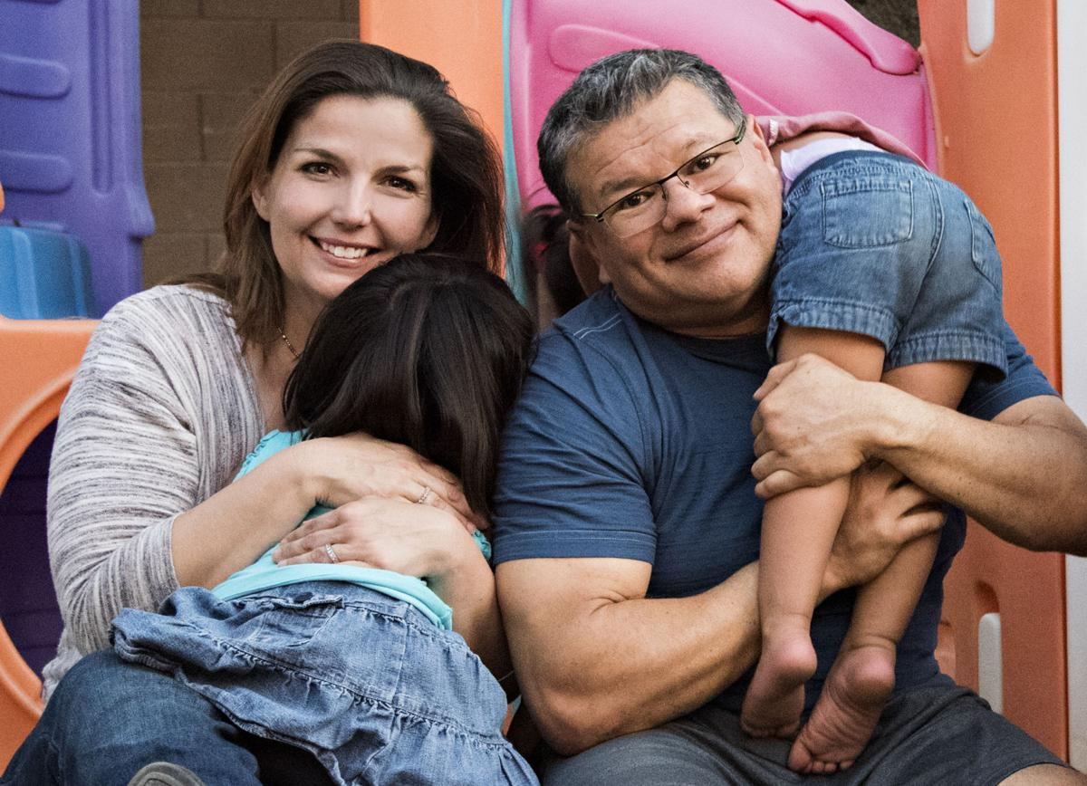 """Shelley and Danny Valdez's daughter plays with the foster girls in their backyard. """"They're the two sweetest girls in the whole world,"""" Shelley said."""