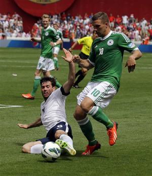Lukas Podolski, Brad Evans