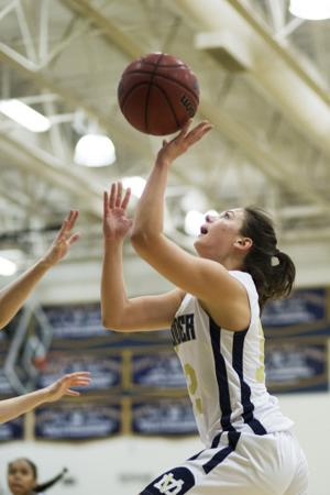 <p>Desert Vista's Madison Golla (12) shoots the ball during the basketball game between Desert Vista and Mesquite at Desert Vista High School on Tuesday, Jan. 5, 2016.</p>