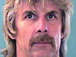 Fugitive turns in self, confesses to crime