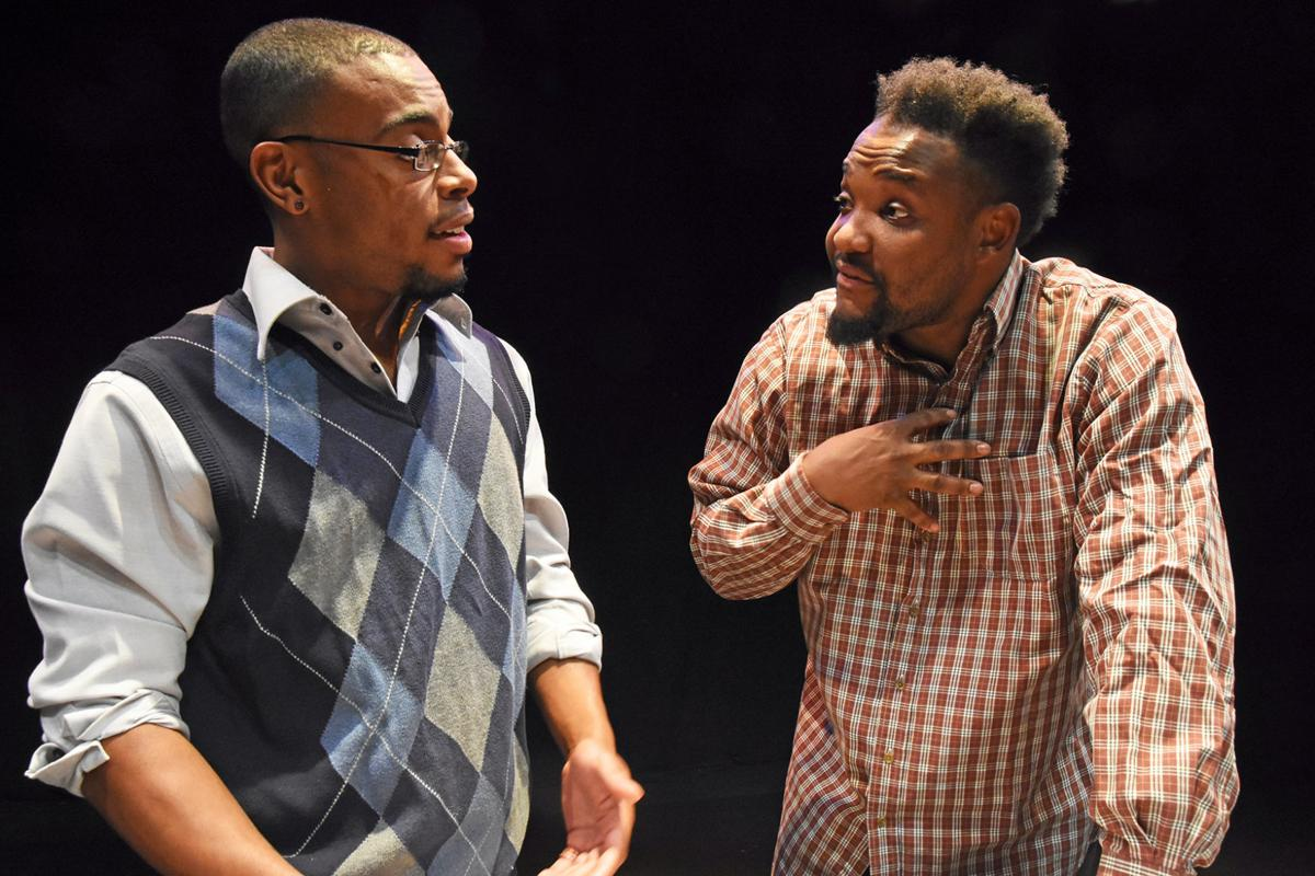 Ahwatukee actor Ralphael Hamilton, right, rehearses a scene with Christopher Dozier