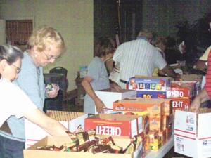 ARC members preparing care boxes