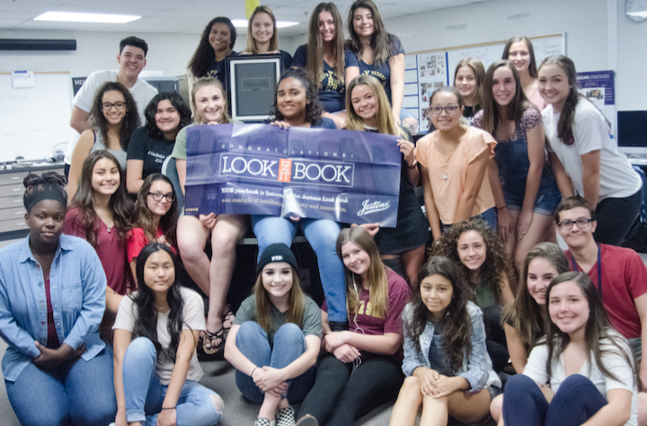 The Desert Vista High School yearbook staff celebrates the national recognition their work received.