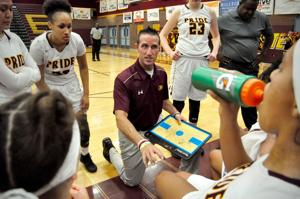 <p>Mountain Pointe girls basketball coach Justin Hager talks strategy during a timeout.</p>