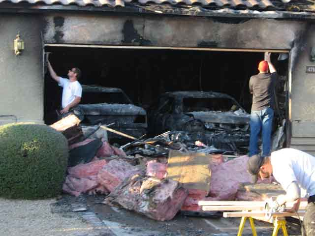 Garage, two cars go up in flames 