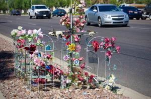 A memorial to Kathy sits along Baseline Road near Kyrene in Tempe.