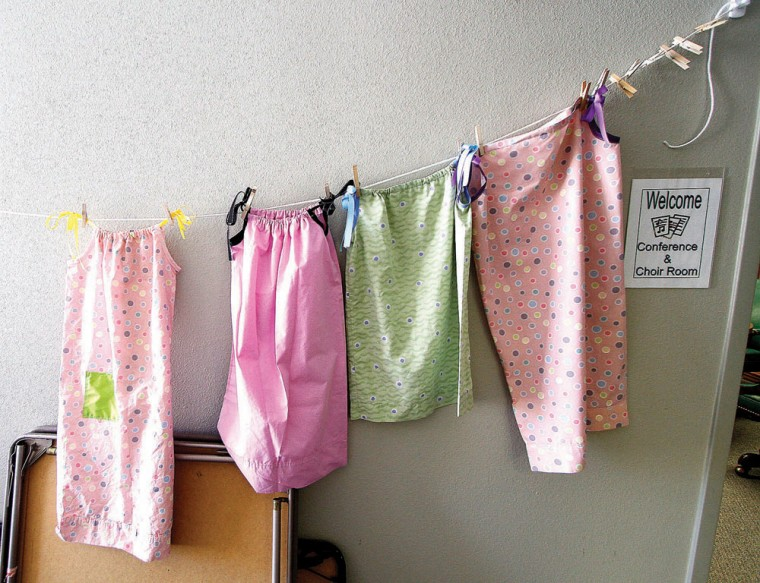 Girl Scouts make dresses for Swaziland