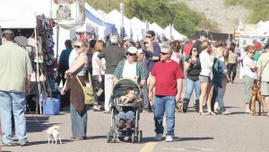 <p>Vendors had plenty for folks to see at the Festival of Lights Kick-Off Party at Desert Foothills Park in Ahwatukee.</p>