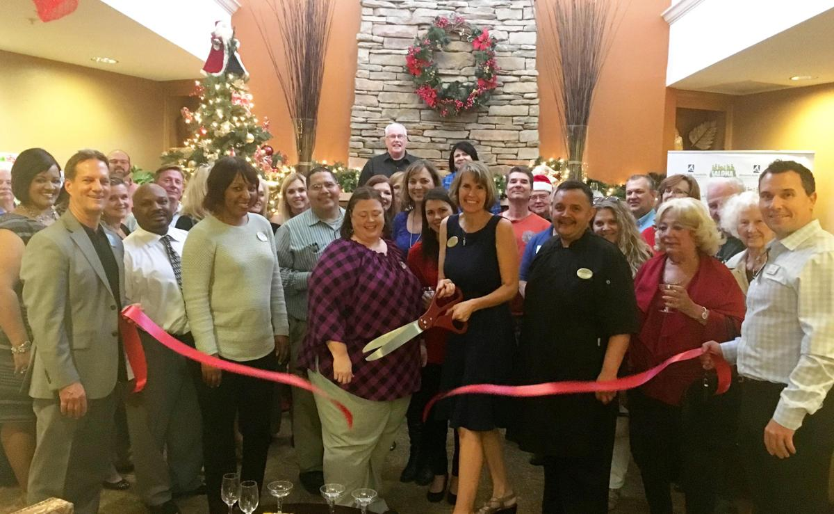 Ahwatukee Foothills Chamber of Commerce members turned out to watch Dawn Grant cut the ribbon on her newly remodeled facilities