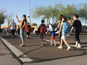 Students observe Walk to School Day