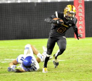 <p>Mountain Pointe's Jaydon Brooks (6) leaves Chandler's Zach Bowers (44) behind as he picks up some yardage.</p>