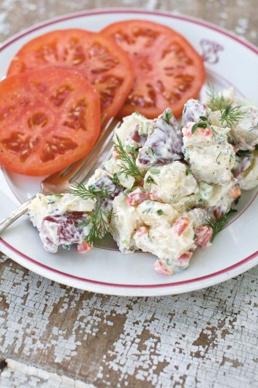 Creamy potato salad with artichokes and herbs