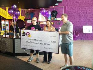 EV resident, 100 Club of Ariz. receive $1K from Planet Fitness