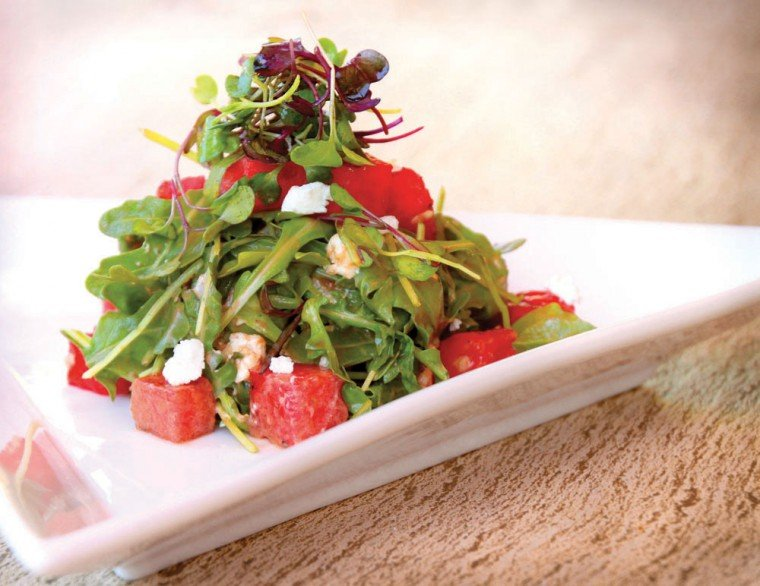 Grilled watermelon with baby arugula and goat cheese salad