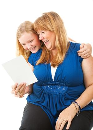 Mom Enjoys Greeting Card From Daughter