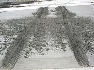 Newly poured concrete ruined by vandals near Cargill.
