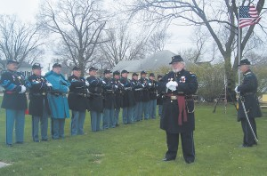 THIS IS A GROUP of the Sons of Union Veterans of the Civil War standing at attention as First Sgt. Lamb addressed those present for the dedication of the Civil War monument in Eddyville. Turn to Page 6 for a story of the event.