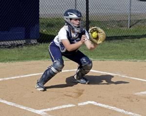 <p>RYAN HUTTON/Staff photoTori Roche secures the ball before making a throw. She picked up many of her catching skills from older brother Harry Roche, a standout behind the plate for Phillips Academy. </p>