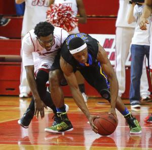 <p>Jacksonville State's JaQuail Townser fights for a loose ball with Morehead State's Brent Arrington. The JSU Gamecocks played host to the Morehead State Eagles Saturday afternoon at Pete Mathews Coliseum. Photo by Trent Penny/The Anniston Star</p>