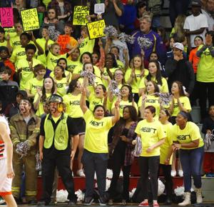 <p>Sacred Heart fans watch their team play Alexandria for the championship of the 2015 Calhoun County basketball tournament Saturday at Pete Mathews Coliseum.</p>