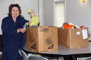 <p>Sandra Caldwell sorts through the donated food.</p>