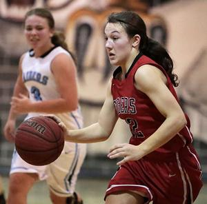 "<p>Alisa Norton takes the ball down the court. Norton was one of the ""Iron Six"" being the only senior in last weeks match-up in New Site.</p>"