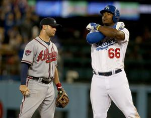<p>The Los Angeles Dodgers' Yasiel Puig gestures after hitting a double off the center-field wall against the Atlanta Braves in the eighth inning at Dodger Stadium in Los Angeles on July 31. (Luis Sinco/Los Angeles Times/MCT)</p>