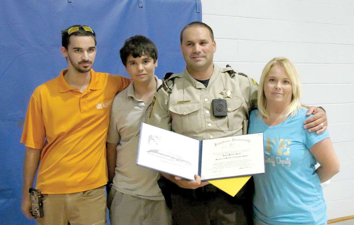 Coosa Central school resource officer surprised with criminal justice diploma at pep rally