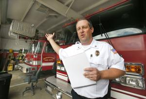 <p>Jacksonville fire Chief Wade Buckner at the fire station, where tracks are crowded in their bays, he says. </p>