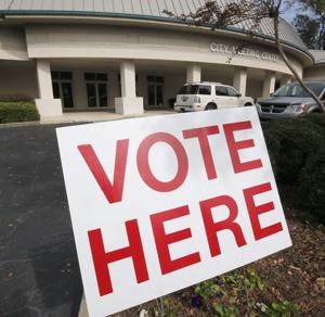 <p>A sign at the Anniston City Meeting Center during voting in the election of 2014. Photo by Stephen Gross / The Anniston Star</p>