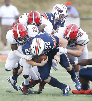 Jacksonville State safety Brandon Bender leads the JSU D as they tackle UT Martin's Trent Garland during the JSU at UT Martin football game. Photo by Stephen Gross / The Anniston Star.