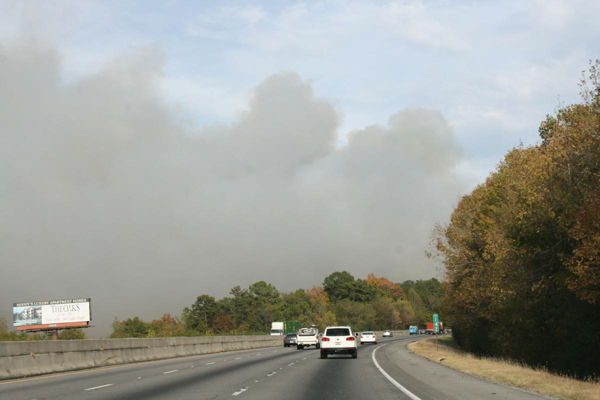 UPDATED: Residential, commercial structures threatened by fire off Interstate 20 near Leeds, Moody