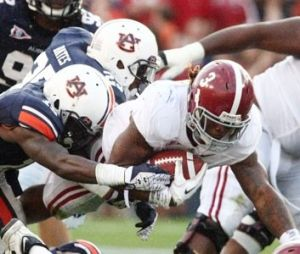 <p>Alabama running back Trent Richardson during a win at Auburn in 2011. Photo by Trent Penny/The Anniston Star</p>