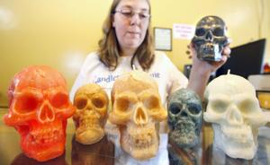 <p>At Stevie Papoi's new shop in Gadsden, the Halloween offerings include life-sized skull candles, as well as scents such as Candy Corn and Zombie Repellent.</p>