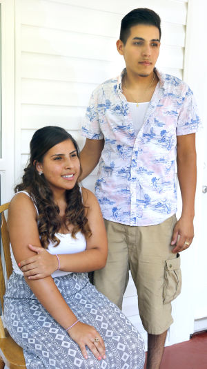 <p>Jaqueline Lopez and her brother, Ramon Lopez, talk about Ramon's decision to participate in duel enrollment courses during high school. Photo by Stephen Gross.</p>