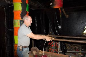<p>Dan Hopkins, who hosts the Haunted Chicken House on his property, stands in the Freddy Krueger room of the haunted house complex.</p>
