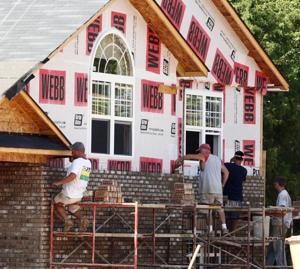Workers building homes at Buckhorn subdivision