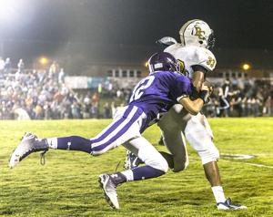 <p>Ranburne's Owen Smith tackles a Randolph County player during the game last Friday night. Smith help lead the way with six tackles to finish the night.</p>