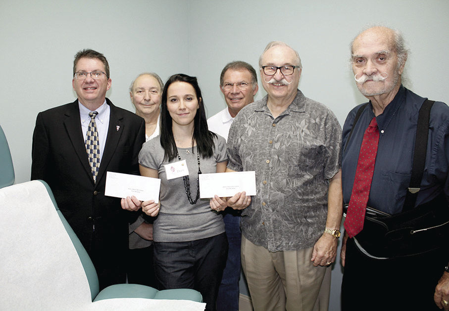 Knights present 2 checks to Ann's New Life Center in Pell City