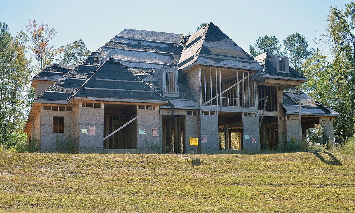 Oxford files suit to demolish unfinished cider ridge home for Cider ridge