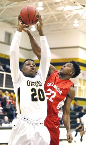 <p>Oxford's Dante Lauderdale shoots the ball over Talladega's Ohyja Garrett during the Talladega at Oxford basketball game. Photo by Stephen Gross / The Anniston Star</p>