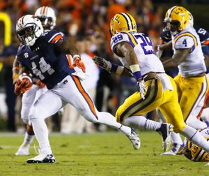 <p>Auburn running back Cameron Artis-Payne makes a cut past LSU safety Rickey Jefferson. Photo by Trent Penny/The Anniston Star</p>