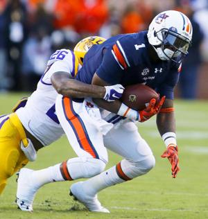 <p>Auburn wide receiver D'haquille Williams is pulled down from behind by LSU safety Ronald Martin earlier this season. Photo by Trent Penny/The Anniston Star</p>