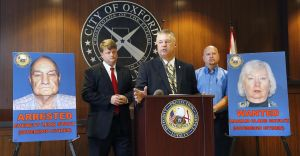 <p>Oxford Police Chief Bill Partridge announces an arrest next to photos of Mariam Clare Shultz and Everett Leo Stout at a press conference that announced the arrest of Stout and details of the charges against the couple. Along with Partridge is Calhoun County District Attorney Brian McVeigh and Calhoun County DA Investigator Alex Ference. Photo by Stephen Gross / The Anniston Star</p>