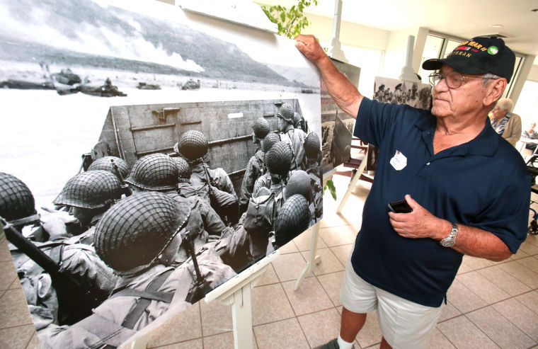 D-Day vet spots himself in photo at Berman (1)